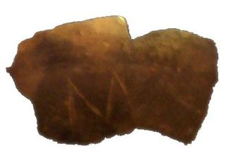 01 Fragment of a clay vessel with an M-shaped incision Neolithic Europe Vinča Serbia Danube 5,300 BC